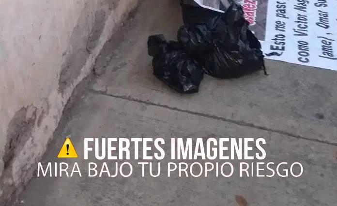 Detrás de lona impresa habían bolsas con los restos humanos de una mujer que al parecer estaban involucrados con la venta de droga.
