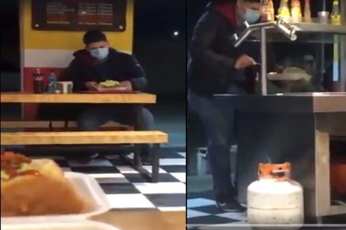 Cachan a sujeto en bufette llenando sus trastes de comida